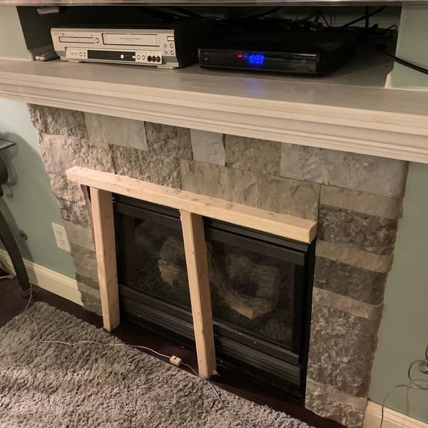 Photo: Fire place mantel and faux stone