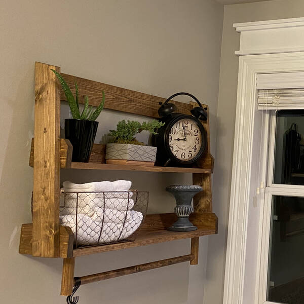 Photo: Hanging ladder shelf with towel bar