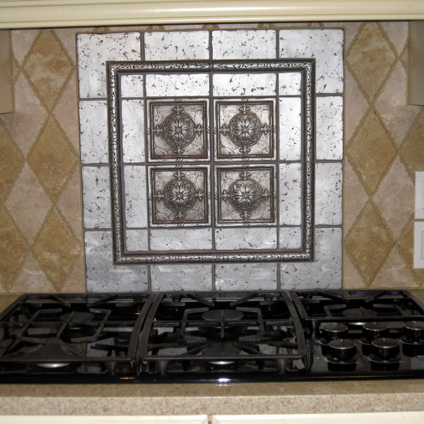 Photo: Tile Backsplash & Framed Accent behind Cooktop