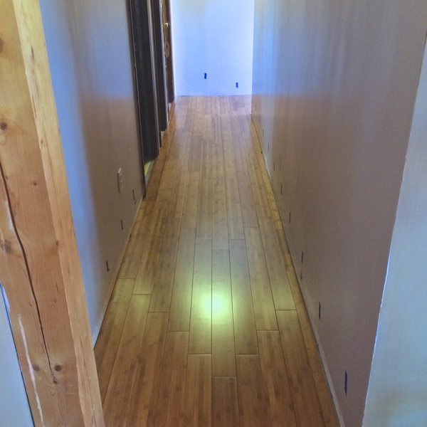 Photo: Installed bamboo flooring in a hallway.