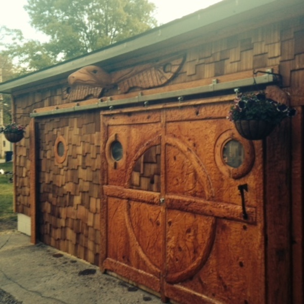Photo: Sliding garage door and Totem pole