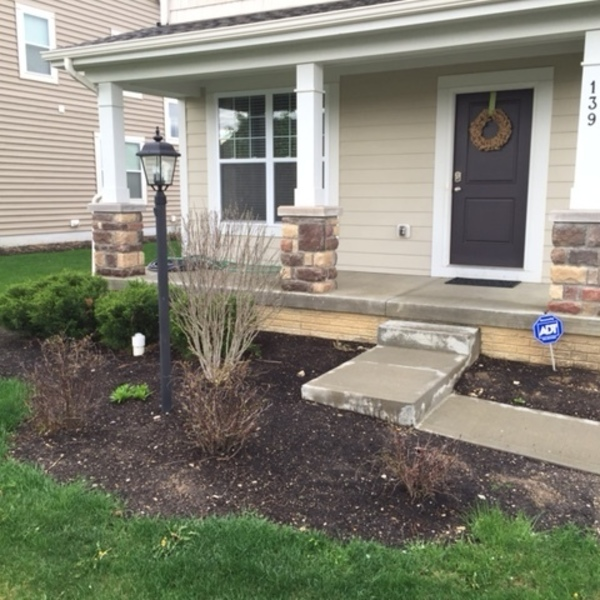 Photo: Outdoor landscaping and retaining wall