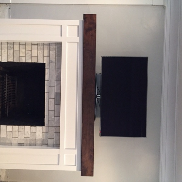 Photo: Custom Fireplace, Mantle & Hearth with hidden compartment for electronics