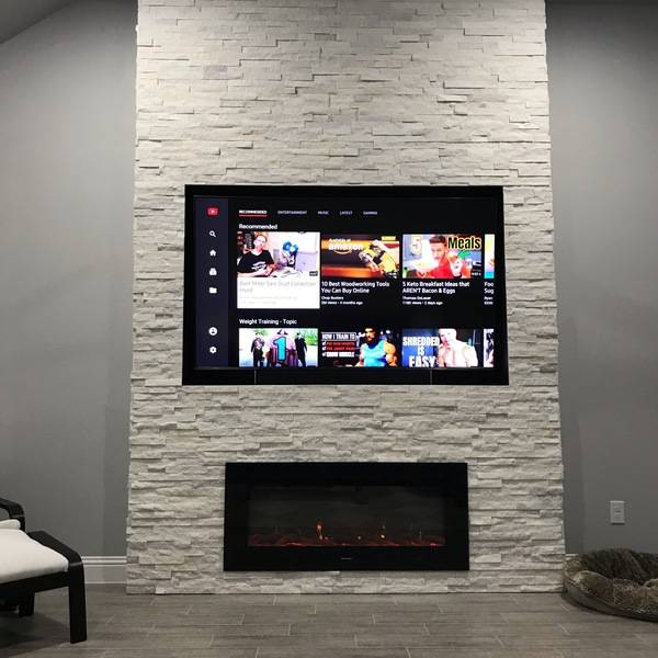 Photo: Stone covered fireplace and tv combo