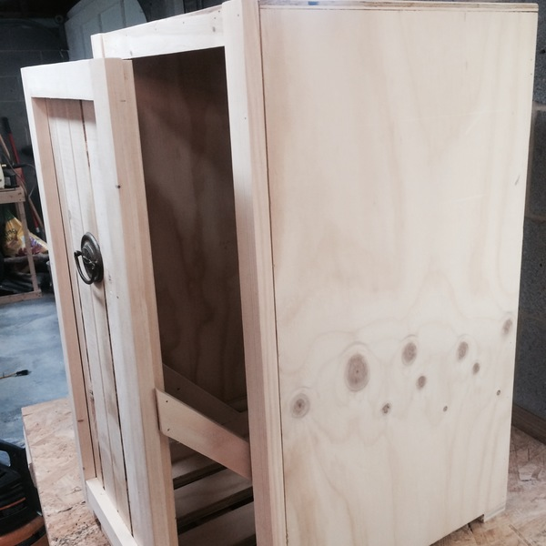 Photo: Pull out trash can cabinet