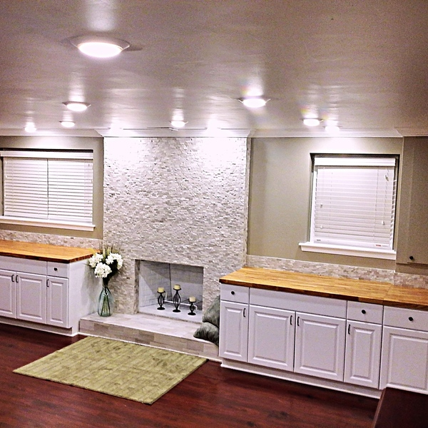 Photo: Basement Reno: New Flooring, Bathroom Appliances, Ceiling & Crown Molding, Tiled Fireplace, Cabinets/Storage, LED Dimmer Lights, Hardware, Under Staircase Remodel