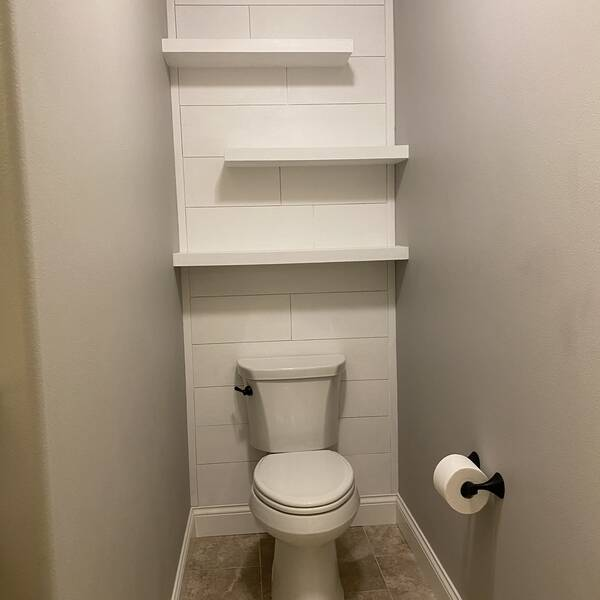 Photo: Accent wall behind the toilet and floating w