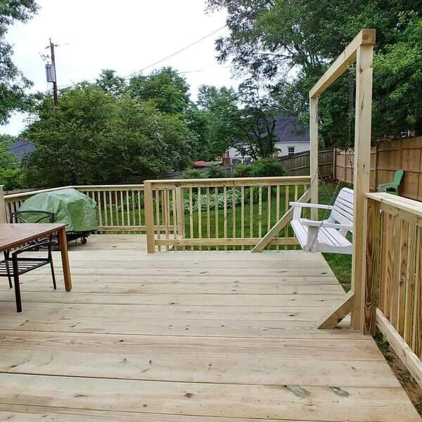 Photo: Fenced back yard and built a new deck